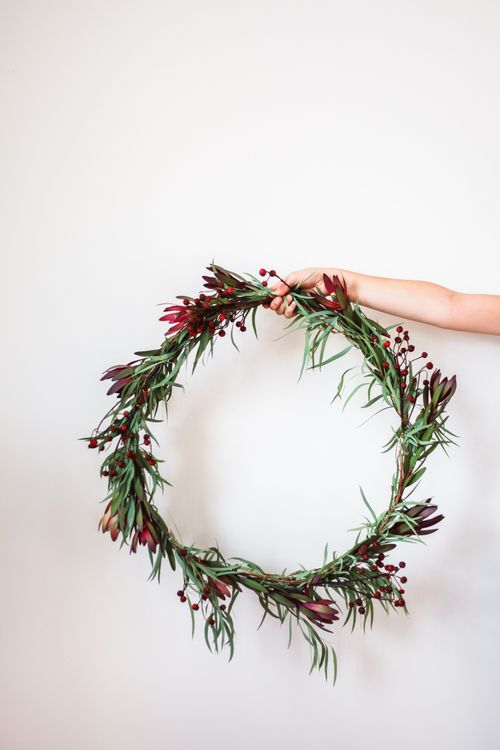 I love making wreaths, it's fun experimenting with different greenery and  flowers! We thought it would be fun to add eucalyptus to this one, it not  only smells amazing but it dries really nice too! We went to Whole Foods  and picked out a few different florals, they always have a great selection.  It's festive without having any traditional holiday garland which is a bit  fun, it's just simple and pretty. Last year we made a big holiday wreath  using only findings from our backyard, so…