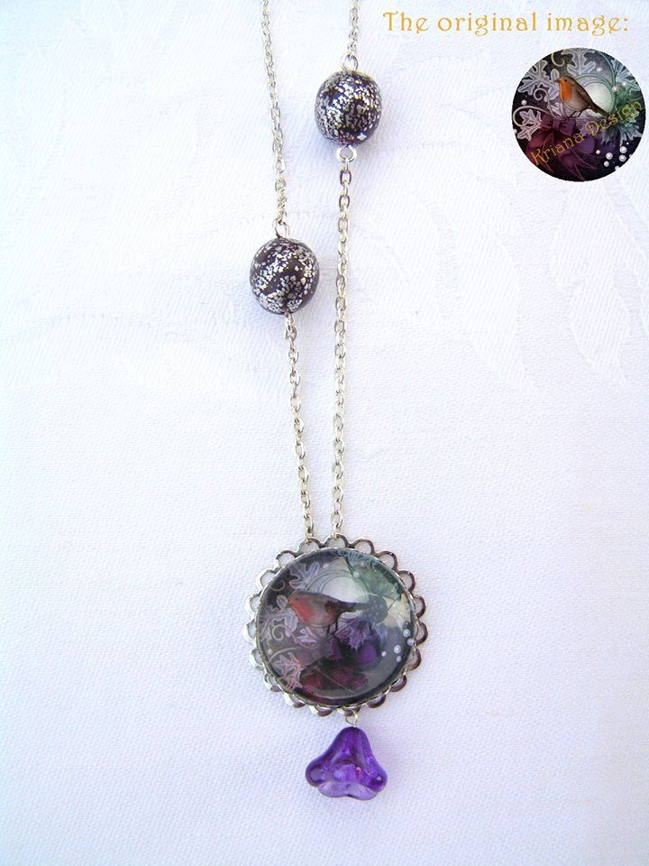 Robin necklace  --    Lovely silver plated glass cabochon picture necklace with (silver) metal leaves decorated polymer clay beads and a beautiful, purple glass flower.