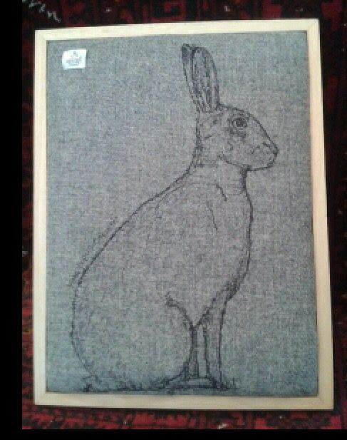 Bad picture of free machine stitched hare on Harris tweed.