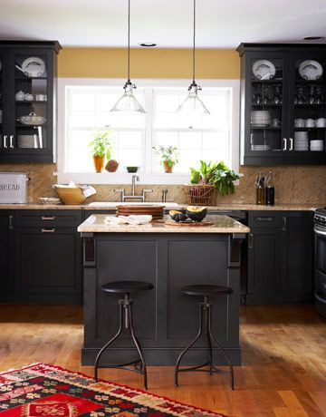Black kitchen cabinets!  Love love love this! So many color options with black cabinets and multi-colored granite counter tops!