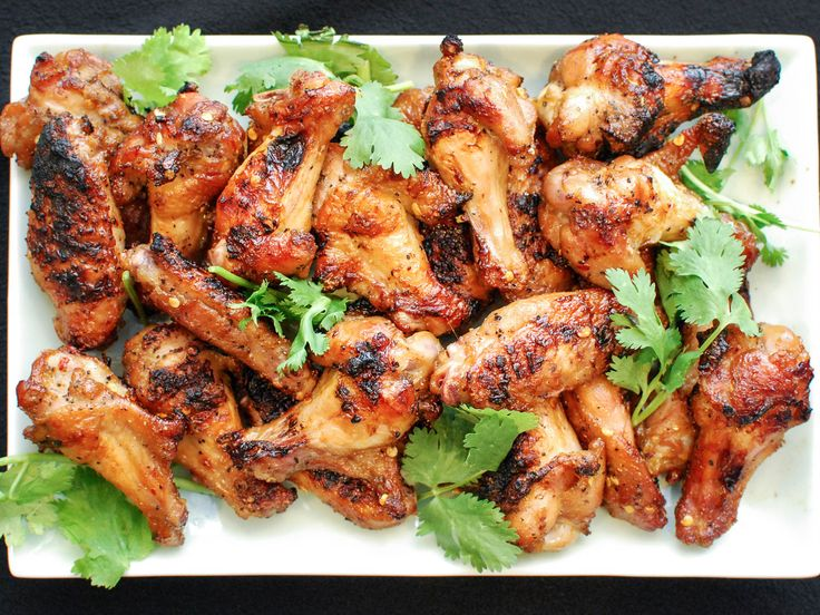 Most of us have our grilling standbys. For some, it's burgers, for others it's ribs. For me, it's chicken wings, and in particular these spicy wings marinated with soy sauce, fish sauce, Shaoxing wine, and spices. Here's how to make them.
