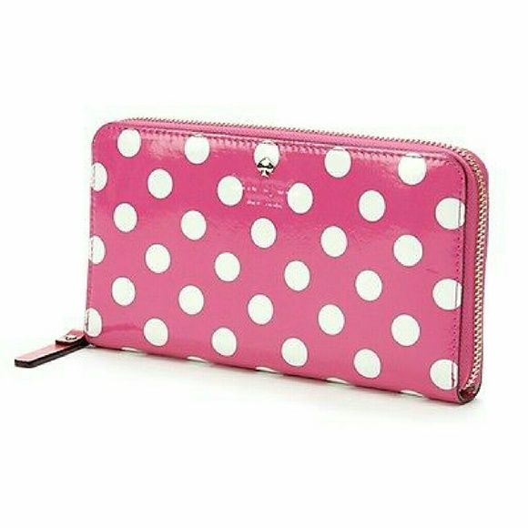Kate Spade wallet SALE Adorable bright pink and white polka dot wallet. Accordion style with plenty of room for credit cards, receipts and an inside zipper pocket for change. Excellent condition as I hardly used it. No snags, flaws, marks, etc. kate spade Bags Wallets