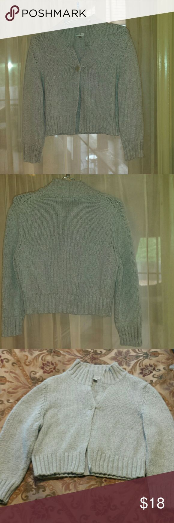 Grey AEO Shrug. Size Medium. Cute 3/4 length grey shrug / bolero by American Eagle Outfitters. Pictures 3 & 4 show true color better than first two pictures. Really cute. Tag says size XL but this sweater shrug is definitely not an XL. It's more like a Medium. Very good used condition. No stains or holes. American Eagle Outfitters Sweaters Shrugs & Ponchos