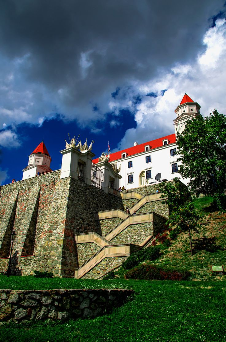 Bratislava Castle. Bratislava Castle is the main castle of Bratislava, the capital of Slovakia. The massive rectangular building with 4 corner towers stands on an isolated rocky hill of the Little Carpathians directly above the Danube river in the middle of Bratislava. The location provides excellent views of Bratislava, Austria and, in clear weather, parts of Hungary. Many legends are connected with the castle. (V)