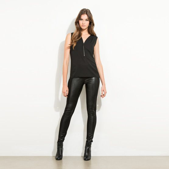 Leggings are every woman's comfort look. These fitted legging style trouser is perfect for those who can't quite see themselves in all over leather. With a leather-look panel at the front, and a stretch rear panel, these pants are perfect for the party season. Head out in a cropped faux fur jacket and you are ready to rock...
