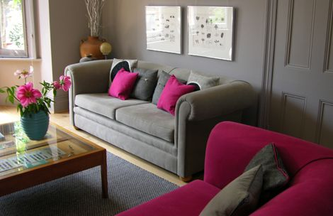 grey couch pink accents grey living room on interior design project