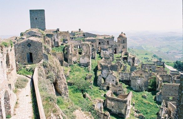 CRACO, BASILICATA, ITALY. Craco was a medieval village first inhabited by Greeks in 540 AD. From then until 1959 it averaged 1,500 residents, landslides & earthquakes caused much . All 1,800 residents packed up & left in 1963. The Passion Of The Christ & Quantum Of Solace were filmed here.