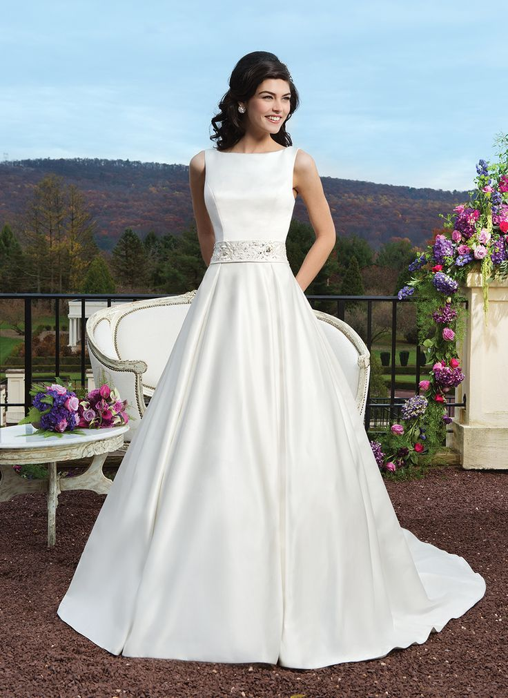 Sincerity wedding dress style 3810 Matte satin ball gown featuring box pleats, a bateau neckline and an  embroidered and beaded detachable matte satin belt.The back is finished  with a V-back and satin covered buttons to the end of the chapel length  train.