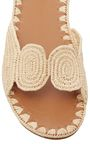 This **Carrie Forbes** slide is rendered in raffia and features a woven detail and minimalist silhouette.