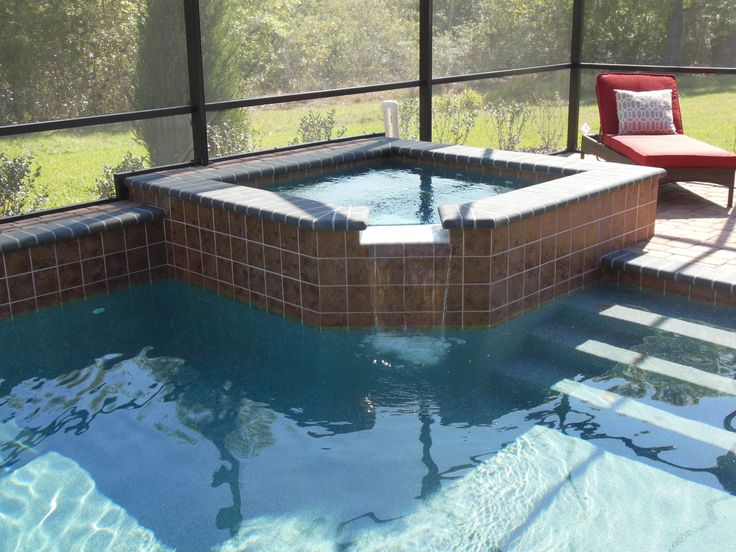 Tampa bay pools spas hot tubs custom design raised for Spa builders