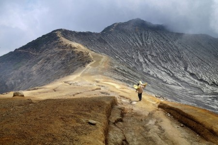 Anggi Anggoman: There's a view of a path that was the crater rim of kawah ijen, Banyuwangi, Indonesia. This rim crater is the only way for the sulfur miners to get to the sulfur weighing station.