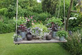 Afbeeldingsresultaat voor kleine romantische tuin