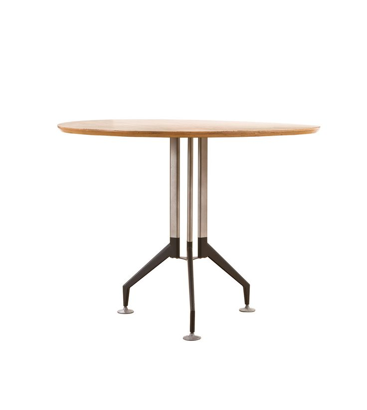 Office table design with light wood tones contrasted with industrial base design.