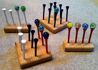 For a different way to work on fine motor skills, while standing or seated, play Tic Tac Toe with marbles/beads and golf tees.  Push 9 golf tees into a block of styrofoam, and then use two different colors of marbles or beads to play Tic Tac Toe.