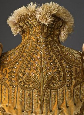 Detail of Mantle, Paris, c. 1891  Emile Pingat, France, active 1860-1896. Wool plain weave and silk velvet with silk and metallic-thread embroidery, glass beads, and ostrich-feather trim.