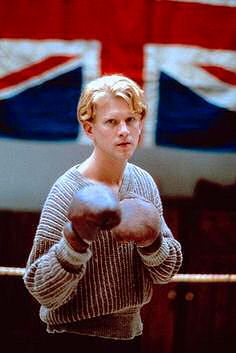 To work off his frustrations, Maurice teaches working-class young men how to box.