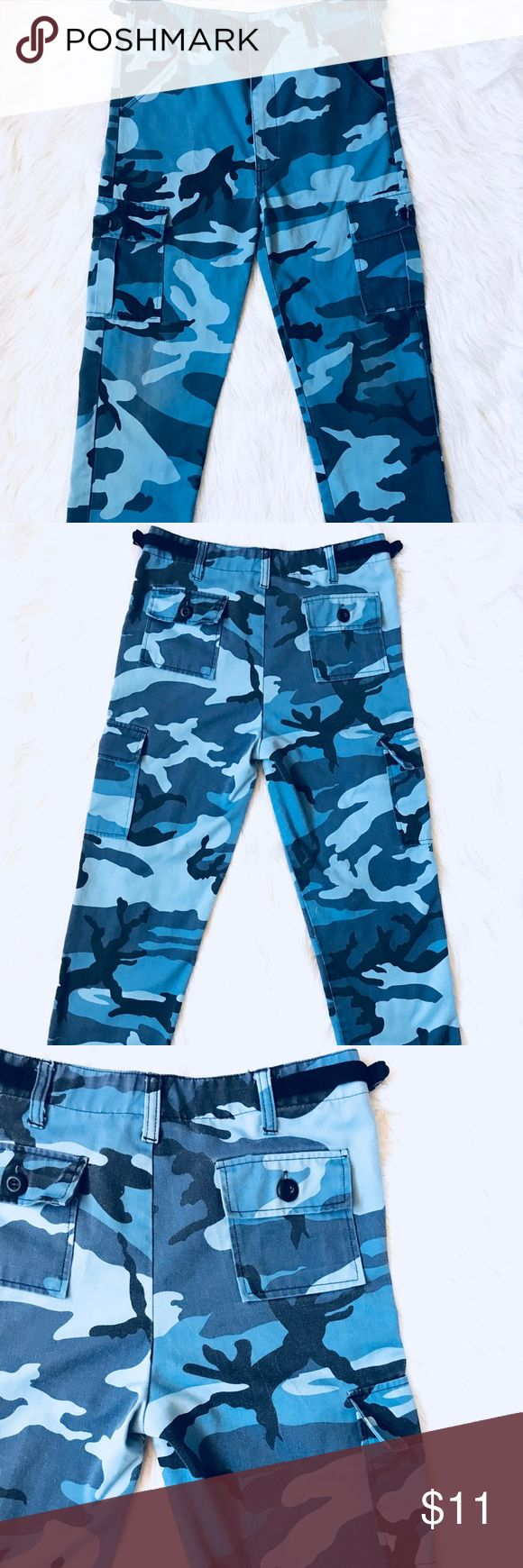 Blue Camo Junior Size 14 Jean Pants with 6 Pockets - Blue Camo Junior Size 14 Jean Pants with 6 Pockets - Tag says Size 14, Inseam up to 26 inches, and Waist 25-29 inches  - Kid Juniors - Has 6 pockets throughout the jeans, two in the front at the top, two on the both sides, and two at the top on the back - Has drawstrings on the bottom of the jeans, one string is ripped (shown in photo) still works though  - In great condition, one knee has a little wear Bottoms Jeans