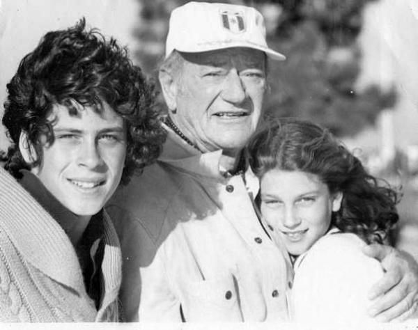 The late John Wayne, center, devoted his later years to spending more time with his family. When he was very ill, he told the doctors that he did not want painkillers because it would make him sleep, and he wanted all of his time left to be with his family. This was in his Biography that I read. It was very touching.