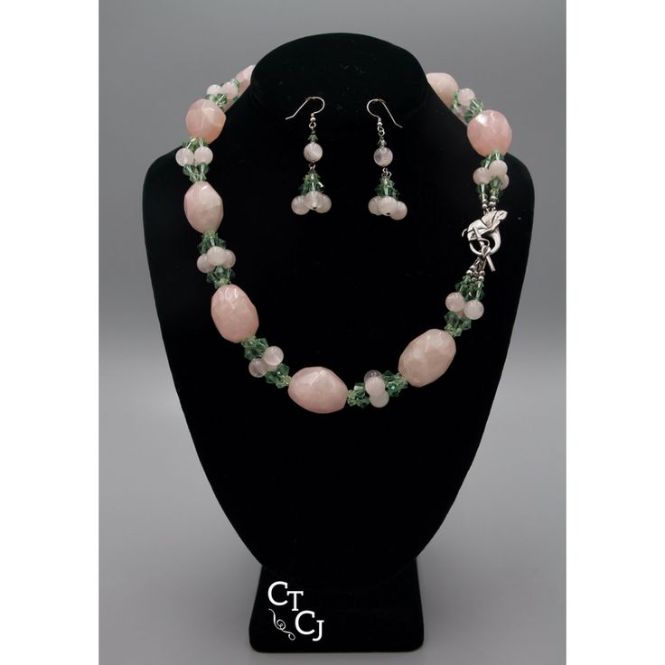 It's like a spring garden! Rose Quartz and Swarovski crystals, closed in sterling silver. We can design just about anything to suit you!