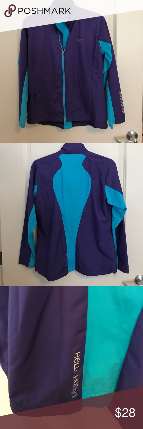 Helly Hansen Training jacket Great purple and teal or aqua color contrast . Worn one time. I bought at Disney World store at Epcot in Norway Sweden shop as I was cold and bought it too tight for waaaay too much $ Helly Hansen Jackets & Coats