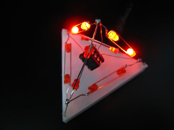I built a LED tetrahedron with a simple, randomized 'snake' animation during 31C3 in Hamburg. The hardware is extremely minimal: Only LEDs, a controller, and some wires. The LEDs act as the supporting structure, so not even a PCB is required! The code is designed to be adaptable to any polyhedron (hopefully), so I encourage you to build a larger one! *** Description of the software and how to adapt it to larger polyhedra coming as well ***