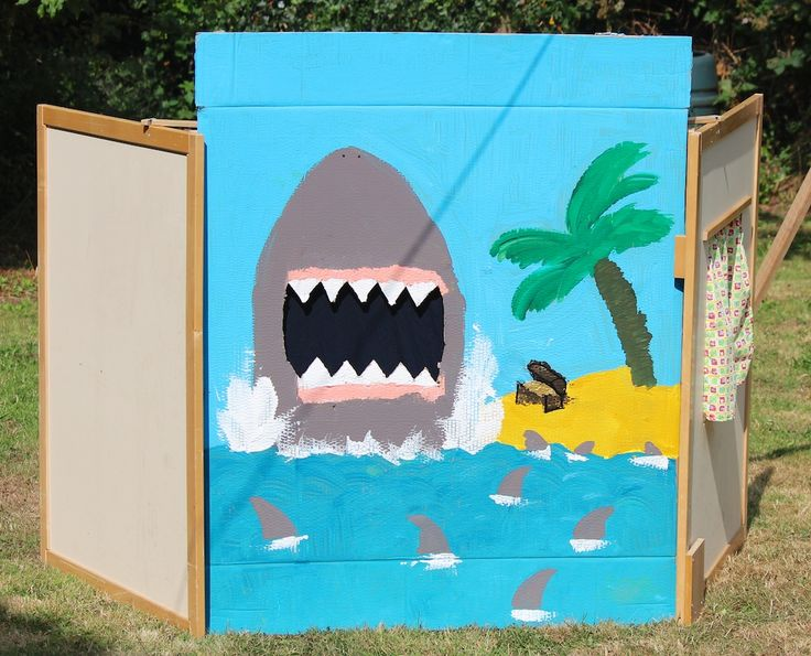 Dual Purpose Shark-infested waters. The mouth is cutout, so can be used for games (feed the shark) and also to take photos of heads in the shark's mouth.