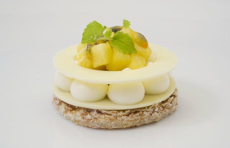 Tropic-Anna: Coconut Dacquoise, Feuilletine Crunch, Piña Colada Crème, Tropical Compote - Chefs Pencil