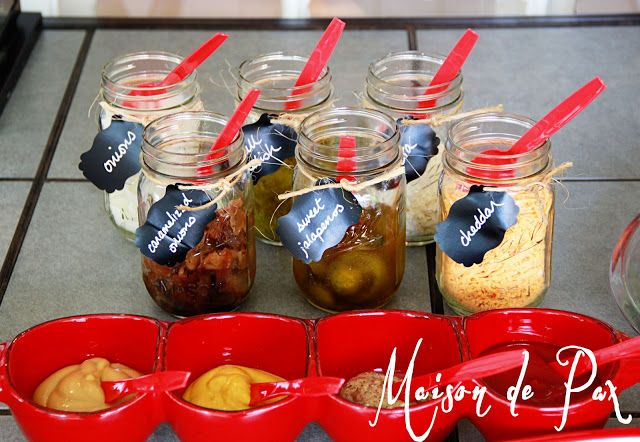 Backyard Barbecue First Birthday Party: gourmet ingredients in mason jars with chalkboard paper labels for a hot dog bar