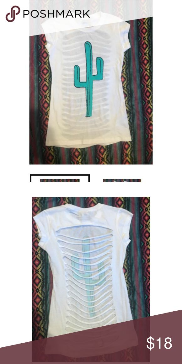 CRAZY TRAIN CACTUS CUT BACK TEE Runs small. Size up :) purchased from crazy train. Price is firm. For lower pricing please check out my website {Www.shopcowboysandangels.com} My listings are from my boutique 🌵 New arrivals weekly! 🌵 I am passionate about my boutique, and can provide measurements, etc upon request! My items sell out FAST, but I do my best to restock our popular items❤️ Tops Tees - Short Sleeve