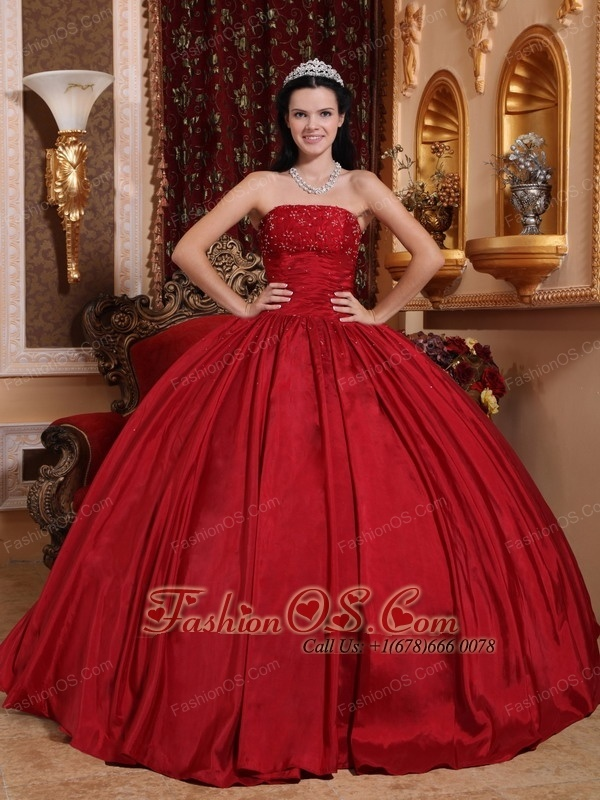 Discount Red Quinceanera Dress Strapless Taffeta Beading Ball Gown  http://www.fashionos.com An elegent long strapless dress in silver,turquoise, fuchsia or any color you like. Sparkling beadwork around the bustline and the ruffled on the waistline. The corset style bodice is finished with a lace up tie back. All eyes will definitely be on you in this stunning evening gown. It has so many design elements that we don't even know where to begin describing it!
