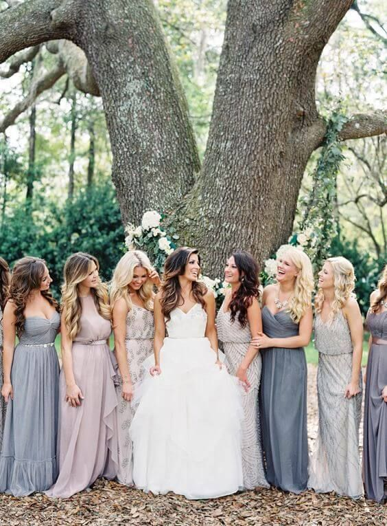 Mismatched silver, blue and lilac bridesmaids dresses, gorgeous Autumn wedding style.
