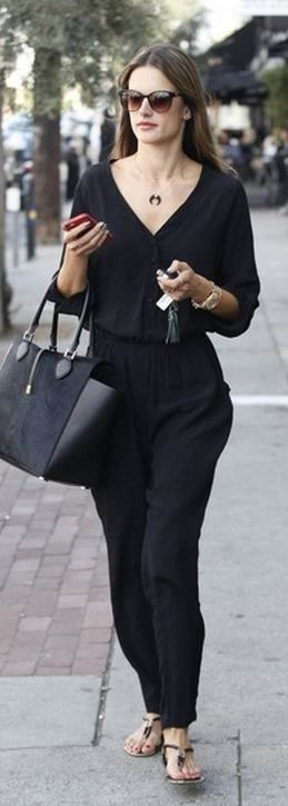 Who made  Alessandra Ambrosio's jewelry, black handbag, and long sleeve jumpsuit?
