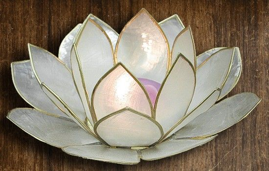 love this blossoming lotus votive candleholder