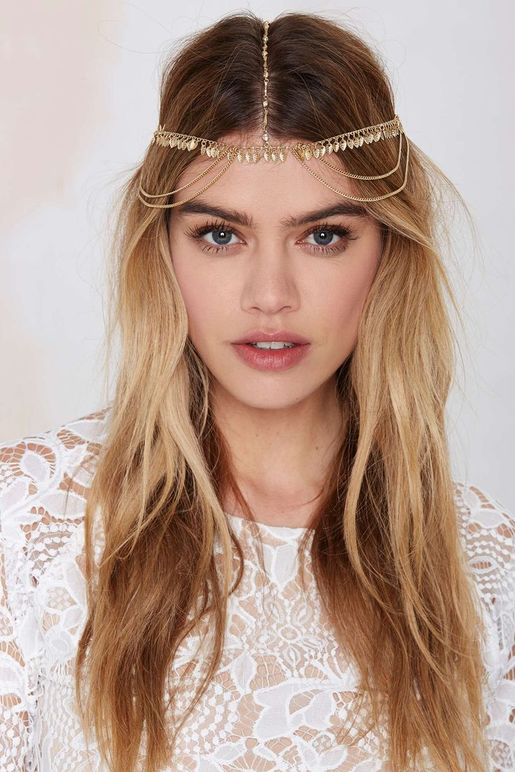 Time to work a goddess vibe. Head Piece is made in a gold metallic and features draping chain detail, dangling leaf embellishment, and rhinestones at center.