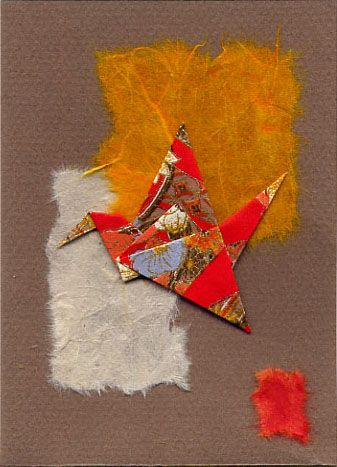 red origami flapping bird on collage