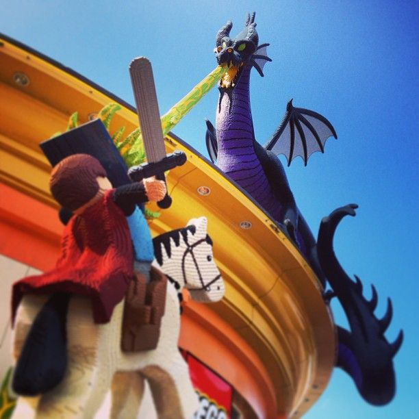 "Photo by daphnemir - she is awesome. Lego Prince Philip fighting Maleficent, scary dragon sorceress from ""The Sleeping Beauty"""