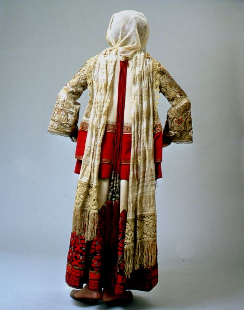 A version of the Attica bridal dress worn in all the villages round Athens. The chemise border embroidery composed of extremely difficult and imaginative motifs, was often covered with gold embroidery, a gift from the bride groom to the bride.    TEXMEDIN Digital Library