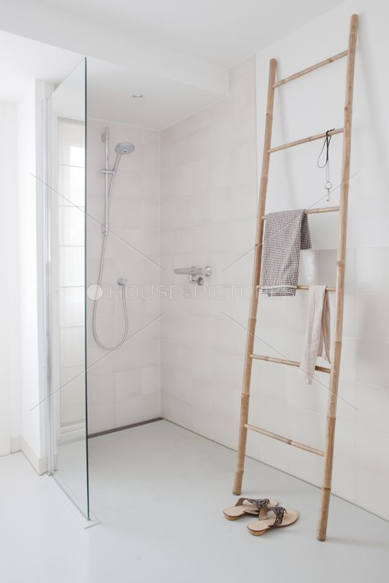 We love the free standing ladder to use as a towel rack. What do you think of this #bathroom? www.budgetbathandkitchen.com