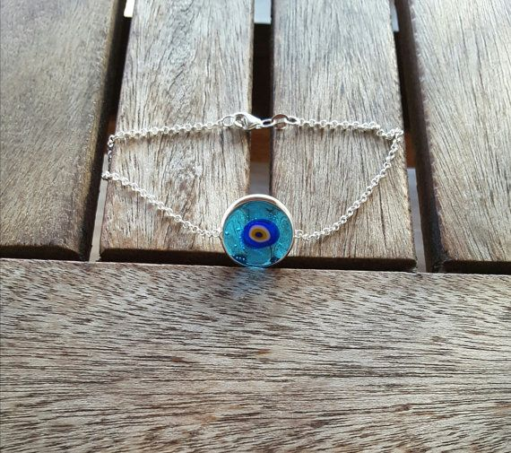 Check out this item in my Etsy shop https://www.etsy.com/listing/115438790/glass-evil-eye-silver-bracelet