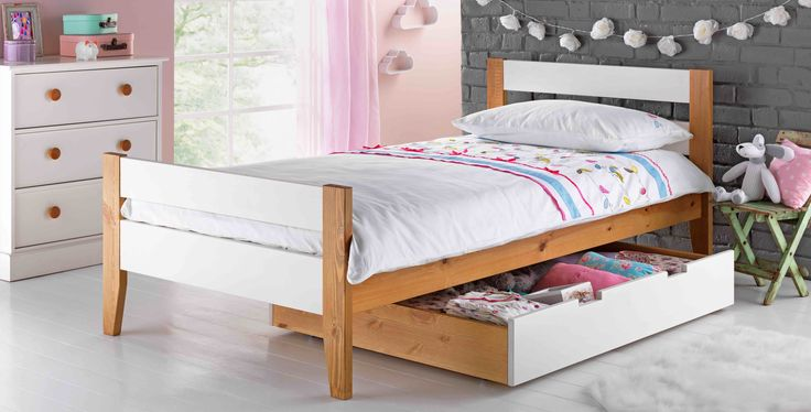 The Two Tone Wooden Single Bed with Drawer in White is suitable for any child's bedroom for comfort and added storage.