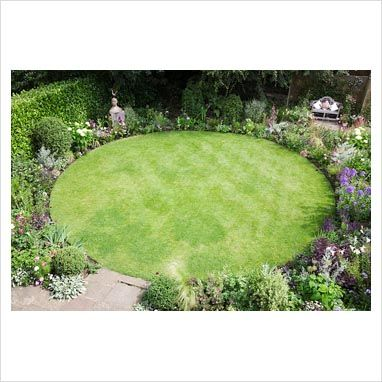 circular lawn bordered by annuals + perennials