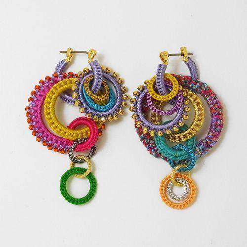 Colorful, unique crocheted hoop earrings.