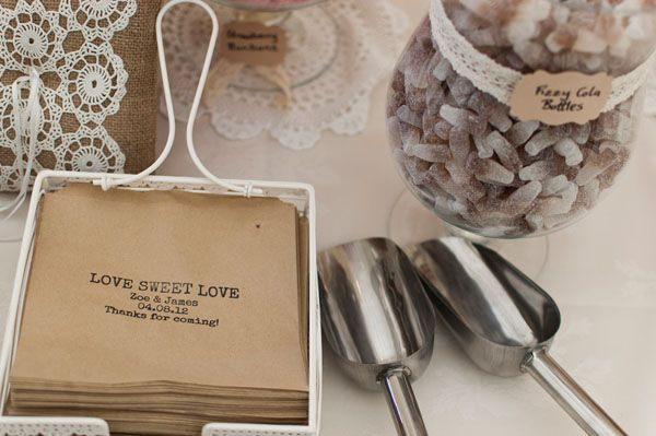 Wedding favour idea - Sweetie table set up for the reception which the B stocked with nostalgic sweets and had traditional brown paper bags set out as favours at each place setting.