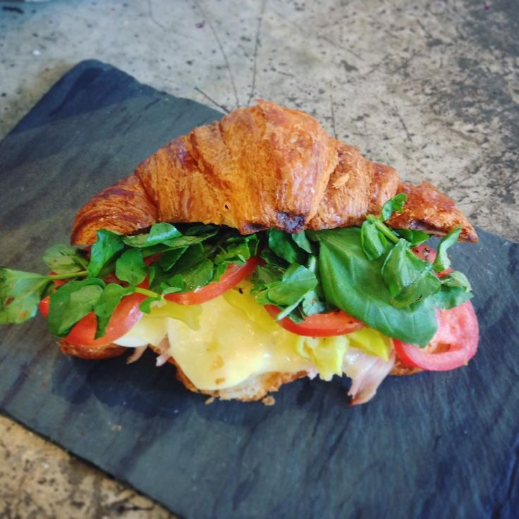Special is a breakfast rosemary ham sandwich, with medium boiled egg, melty fontina, fresh tomato, pepperoncini, garlic aioli, and watercress on toasted croissant. Whoo!