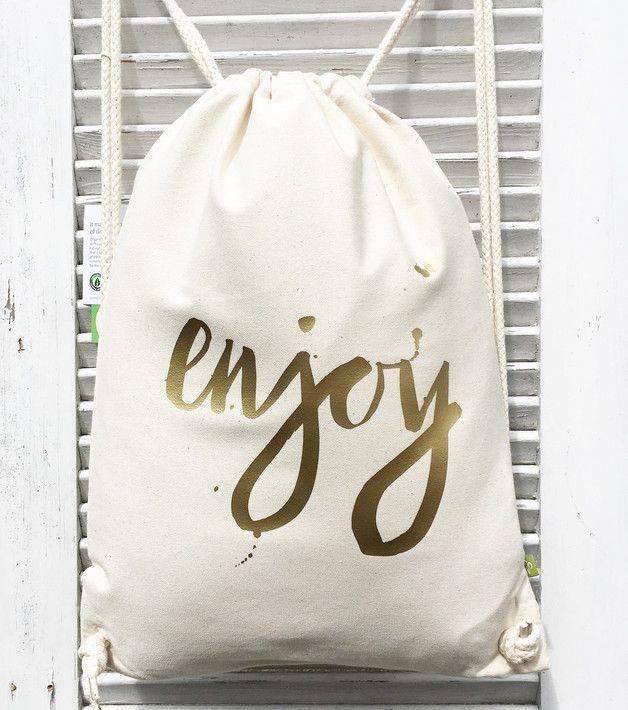 **enjoy**  Druck von crownprintcess  Schönes für zu Hause  **_Ein echt fetter Rucksack aus Organic Cotton._**  Rucksack / Turnbeutel aus Biobaumwolle  • gemäß der Control Union...
