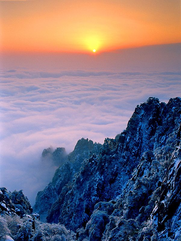 Sunrise on Mount Huangshan!!! Mount Huangshan, or Yellow Moutain, is located in Huangshan City in China. It is one of the Three Mountains and the Top 10 Scenery Areas in China. Mount Huangshan was listed in the World Cultural and Natural Heritage List in 1990.