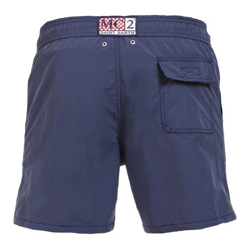 "BLUE OWNER P SWIM SHORTS WITH SKULL Solid dark blue Long Swim Shorts featuring a skull and ""PIRATES DE SAINT BARTH"" embroidery at lateral side. Two front pockets and back Velcro pocket. Internal net. Elastic waistband with adjustable drawstring. COMPOSITION: 100% POLYESTER. Model wears size M, he is 189 cm tall and weighs 86 Kg."