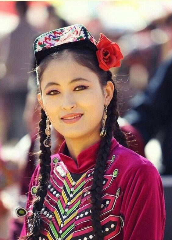 Uyghur beauty in traditional dress.
