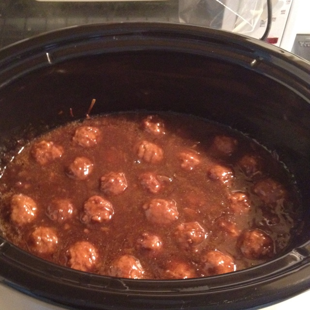 Homestyle meatballs in gravy in crockpot.  1 packet lipton onion soup mix 1 packet beefy onion soup mix 1 packet mushroom onion soup mix 2 jars Heinz beef gravy  1-2 cups water(depends on the consistency you want) 1 bag frozen homestyle meatballs  In crockpot mix all ingredients, the add meatballs. Cook on low 6-7 hours. Serve over egg noodles or rice