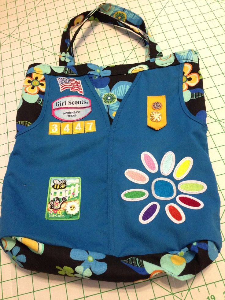 @Ali Velez Martin  you are crafty and a sewing person.. think you could make something like this for my girls with their old vests? They are both moving up and I want something fo them to still show off the cute stuff :)      Girl Scout Daisy vest made into a tote bag - good idea to make a scrapebook like this for each level of girl scouts, this being the daisy scout